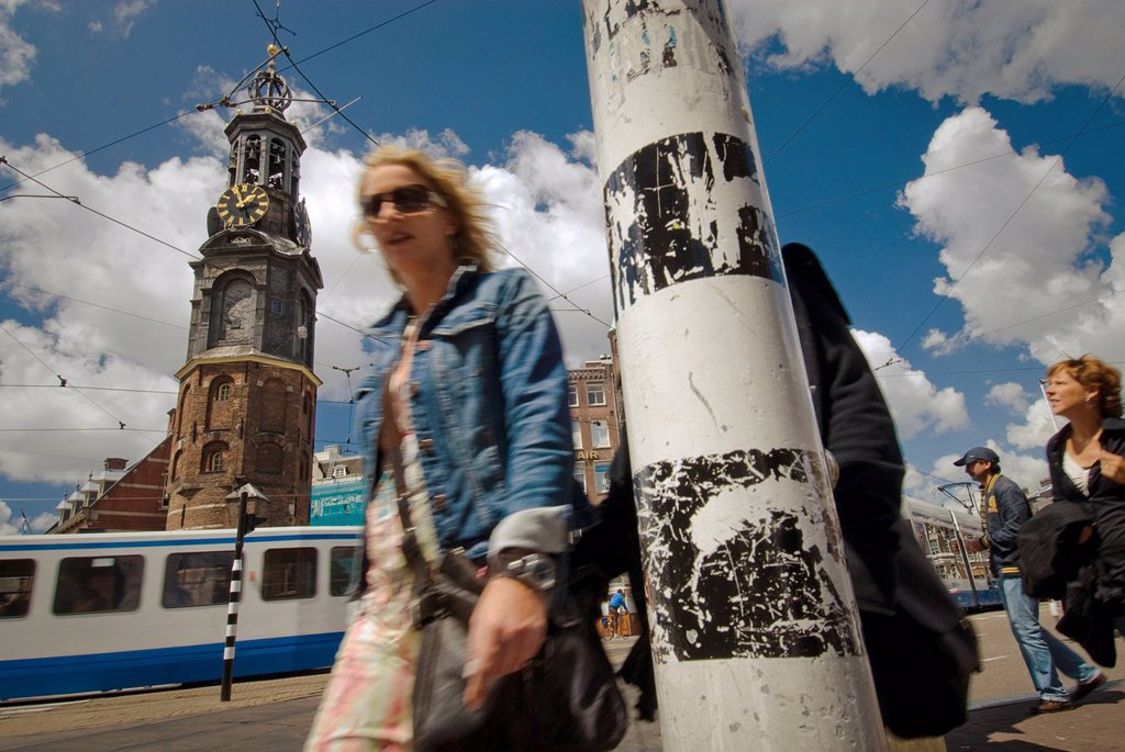 Pedestrian in front of Munttoren, Mint Tower on Muntplein square, Amsterdam, Netherlands, Europe : Stock Photo