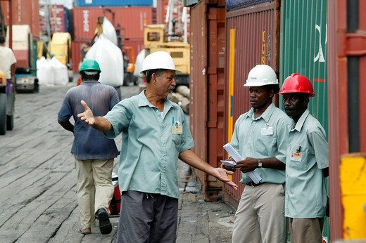 Stock Photo: 1848-56115 Harbourmaster and dock workers at John Fernandes transshipment port in Georgetown, Guyana, South America