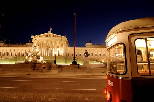 Tram streetcar in front of the Parliament building in Vienna, Austria : Stock Photo
