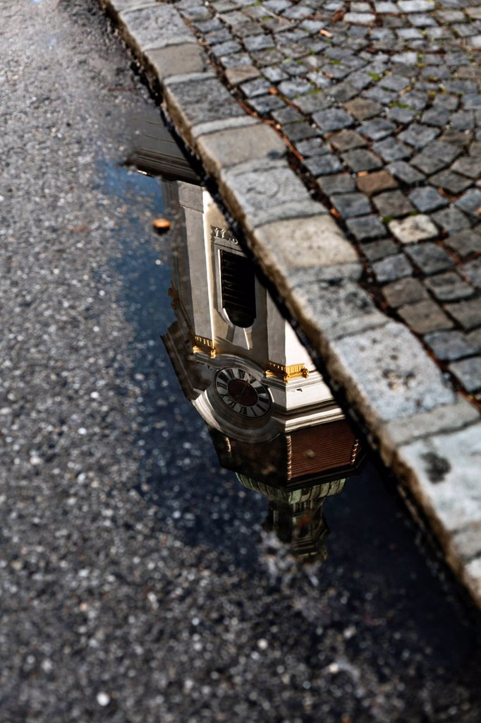 Stock Photo: 1848-562939 Steinertor gate reflected in a puddle of water in Krems, Wachau, Lower Austria, Austria