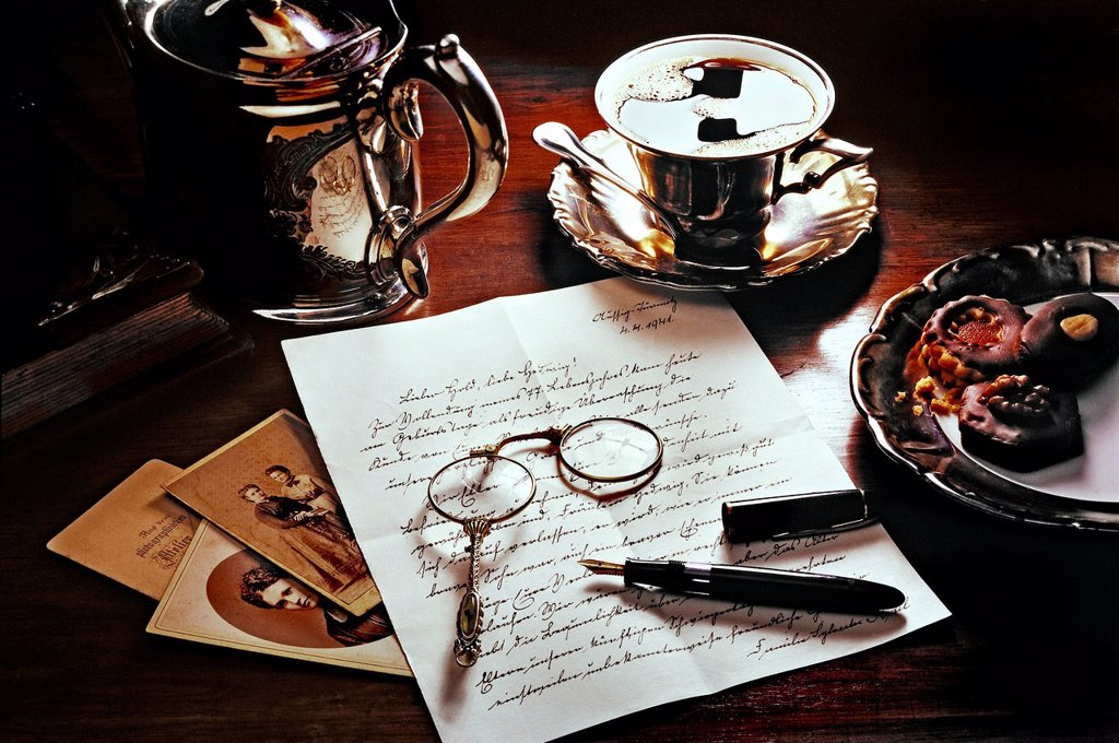 Stock Photo: 1848-563740 Old letter with coffee, cookies, fountain pen, photos and a lorgnette