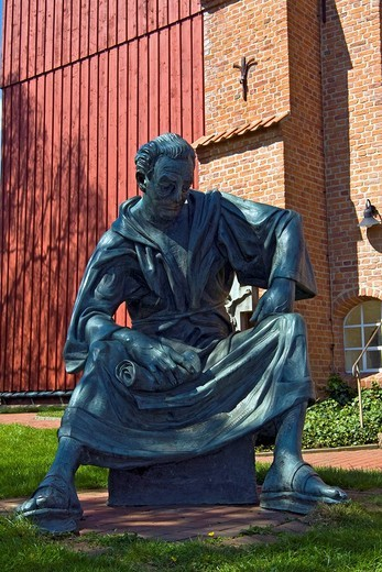 Stock Photo: 1848-56387 Bronze sculpture of the cleric Heinrich in front of the historic Church St. Martini et Nicolai in Steinkirchen, Altes Land, Lower Saxony, Germany, Europe