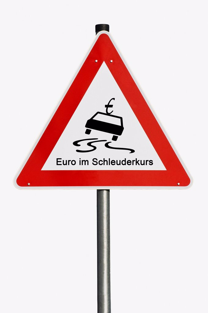 Stock Photo: 1848-564460 Traffic sign, danger ahead, euro in a spin, symbolic image