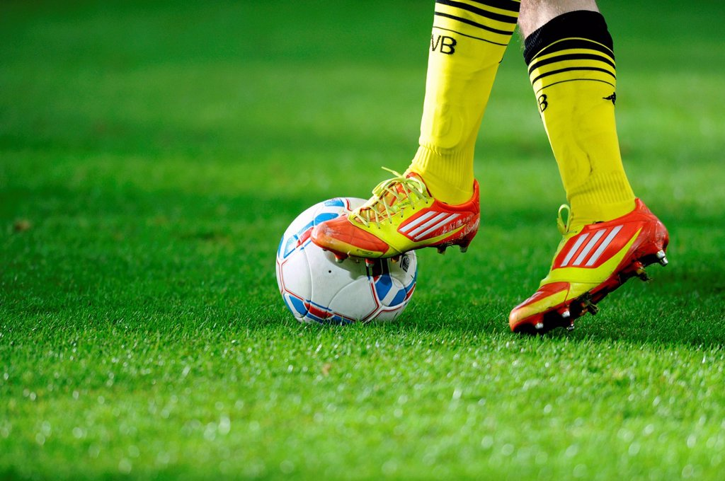 Stock Photo: 1848-565454 Legs and Adidas shoes of a Dortmund player with the league ball, preparatory match for the second round of the tournament season 2011_2012, Fortuna Dusseldorf _ Borussia Dortmund, Stadtwerke Duesseldorf Wintercup in the ESPRIT Arena, Dusseldorf, North Rhi. Legs and Adidas shoes of a Dortmund player with the league ball, preparatory match for the second round of the tournament season 2011_2012, Fortuna Dusseldorf _ Borussia Dortmund, Stadtwerke Duesseldorf Wintercup in the ESPRIT Arena, Dusseldor