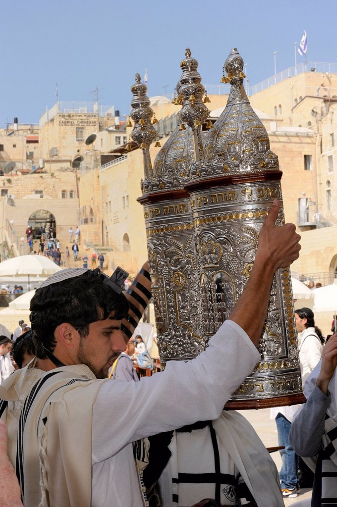 Torah being lifted in all cardinal directions during the Bar Mitzwa ceremony, Jewish quarter of the historic centre in the back, Arab quarter, Jerusalem, Israel, Middle East : Stock Photo