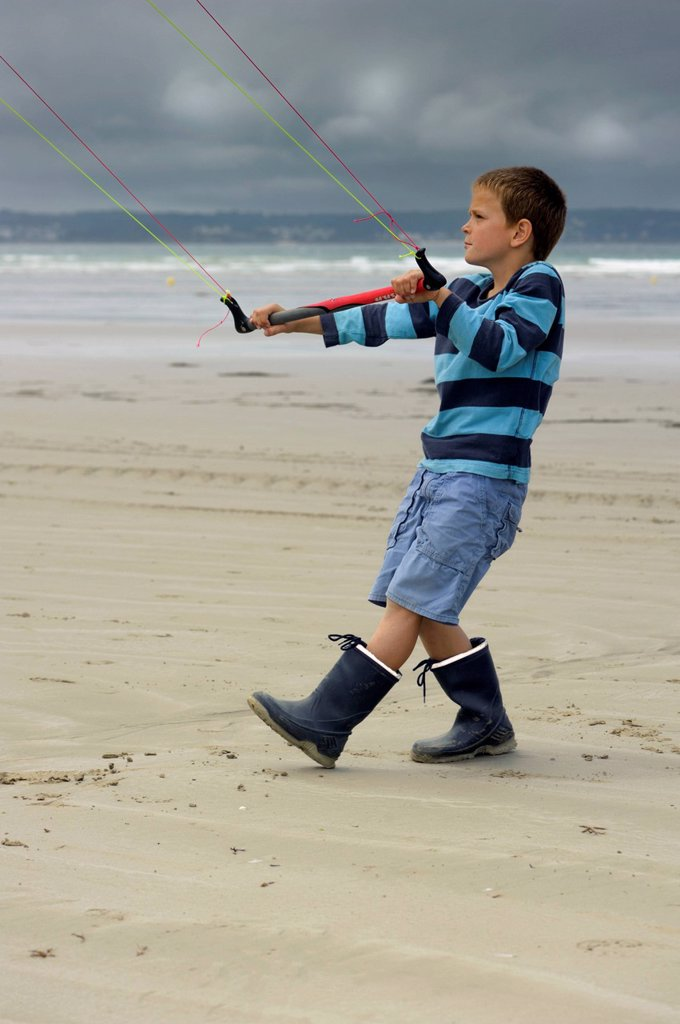 Stock Photo: 1848-567019 Boy flying a towing kite on the Atlantic beach, Finistere, Bretagne, Britanny, France, Europe, PublicGround