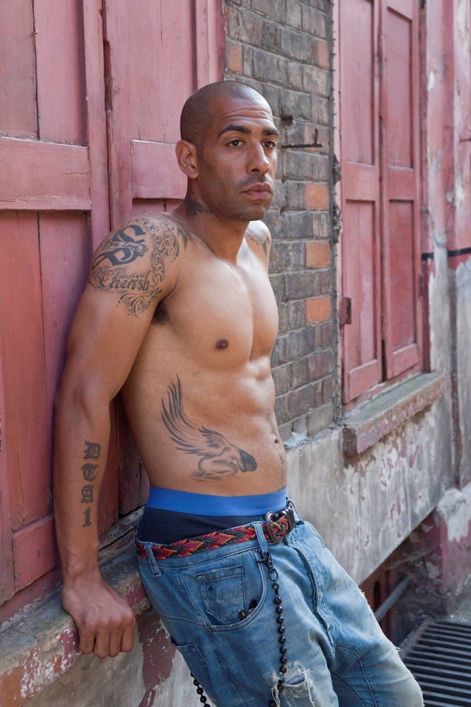 Stock Photo: 1848-567056 Bare_chested mixed_race British man with tattoos, East End, London, England, United Kingdom, Europe