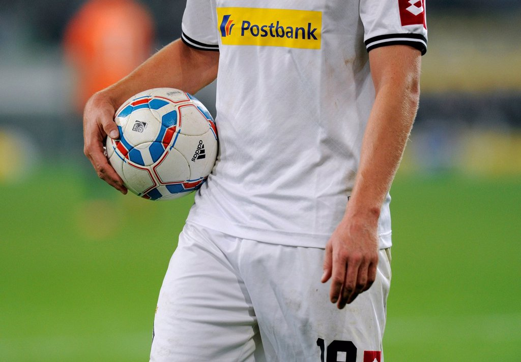 Gladbach player holding football under his arm, German football Bundesliga, VfL Borussia Moenchengladbach vs. SV Werder Bremen 5:0, Nordpark stadion, Moenchengladbach, North Rhine_Westphalia, Germany, Europe : Stock Photo