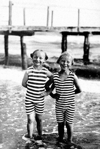 Historic photograph, twins, striped bathing suits, around 1920 : Stock Photo