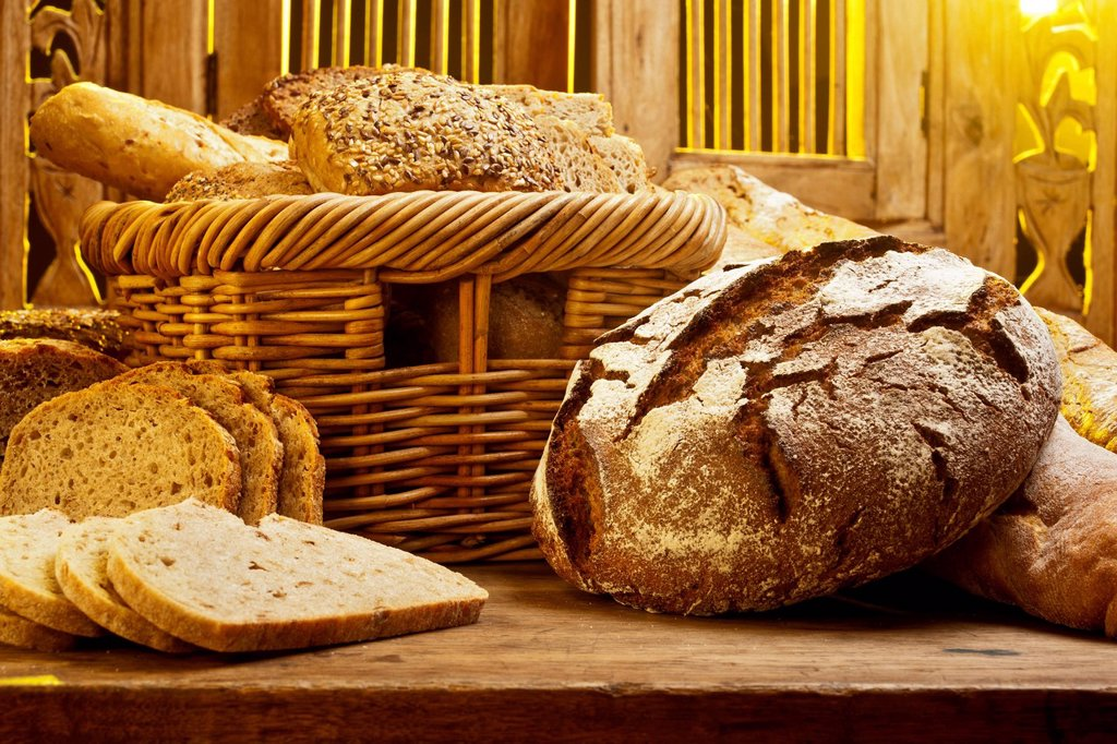Different types of bread on a table : Stock Photo