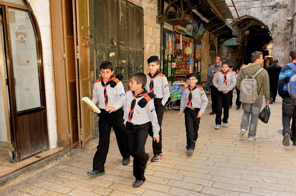 Boy scouts in uniform passing through the Arab quarter in the old city of Jerusalem, Israel, Middle East : Stock Photo