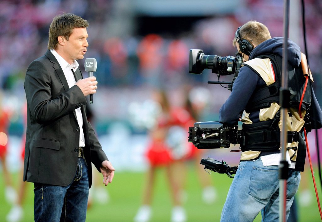 Stock Photo: 1848-567947 Thomas Helmer, host of ´Sport 1´, in front of the camera, Bundesliga, federal league, 1. FC Koeln _ Hannover 96 2:0, RheinEnergieStadion stadium, Cologne, North Rhine_Westphalia, Germany, Europe
