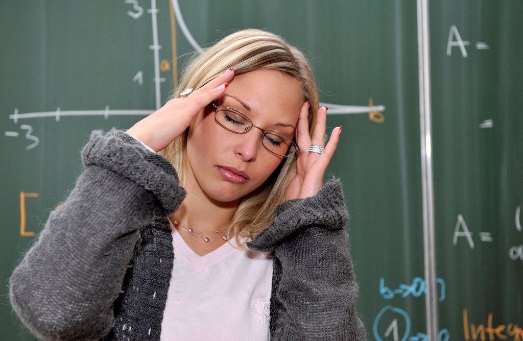 Stock Photo: 1848-568402 Burnout, trainee teacher, prospective teacher, young teacher, exhausted, desperate, mathematics, blackboard, classroom, Baden_Wuerttemberg, Germany, Europe