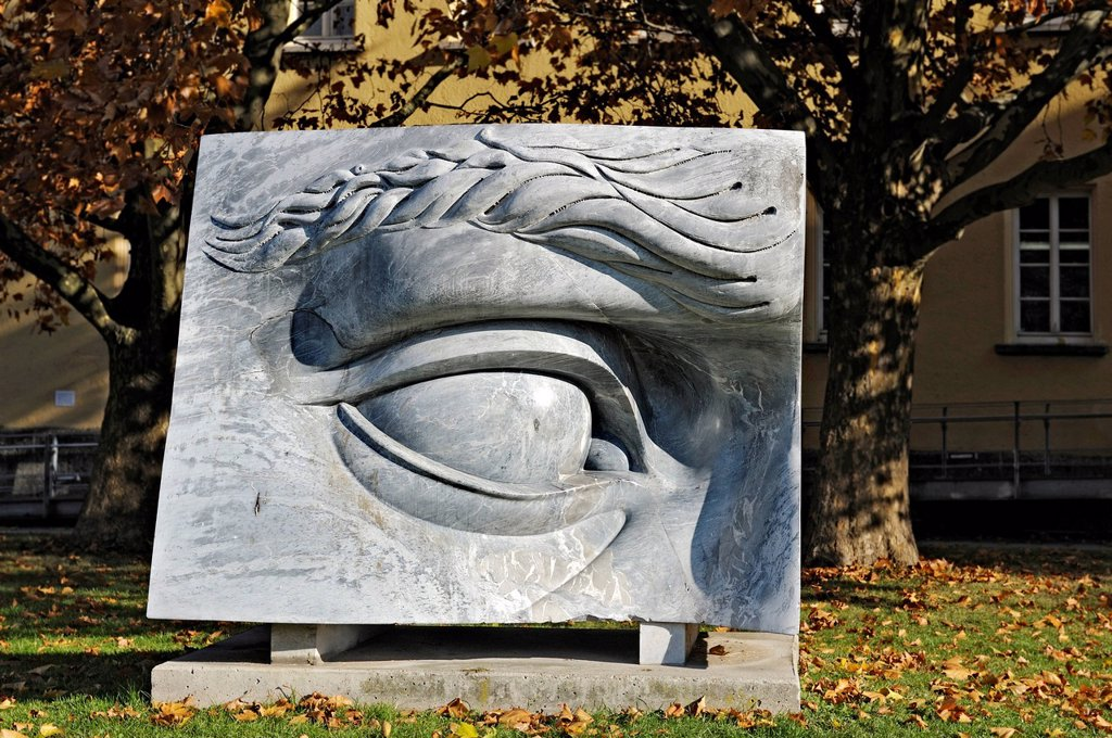 Oculus oblivionis, eye of oblivion, enlargement of the right eye of Michelangelo´s David sculpture, group of sculptures by Anne and Patrick Poirier near the Nordbad swimming pool, Schwabing, Munich, Bavaria, Germany, Europe : Stock Photo