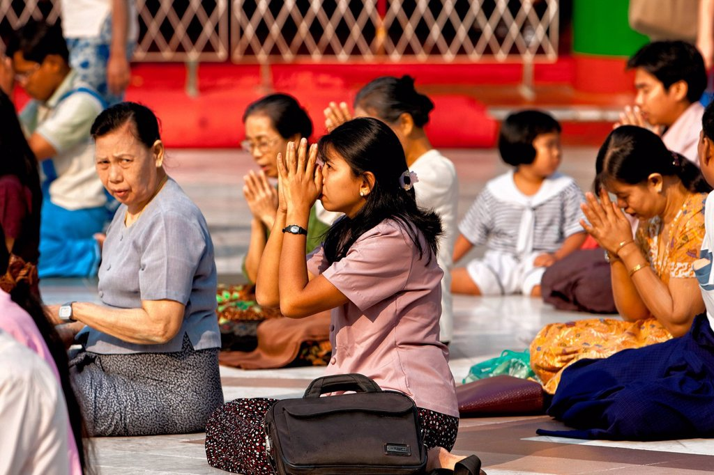 Stock Photo: 1848-569140 Women praying, Shwedagon Pagoda, Yangon, Myanmar, Burma, Southeast Asia, Asia