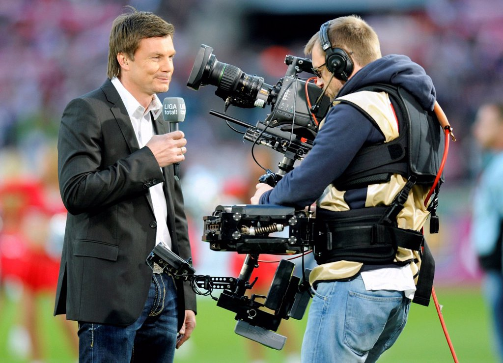 Thomas Helmer, host of ´Sport 1´, in front of the camera, Bundesliga, federal league, 1. FC Koeln _ Hannover 96 2:0, RheinEnergieStadion stadium, Cologne, North Rhine_Westphalia, Germany, Europe : Stock Photo