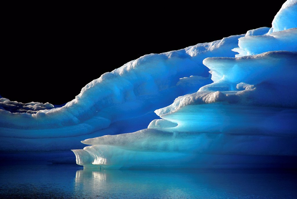 Intensely glowing blue icebergs in Lago Argentino, El Calafate, Patagonia, Argentina, South America : Stock Photo