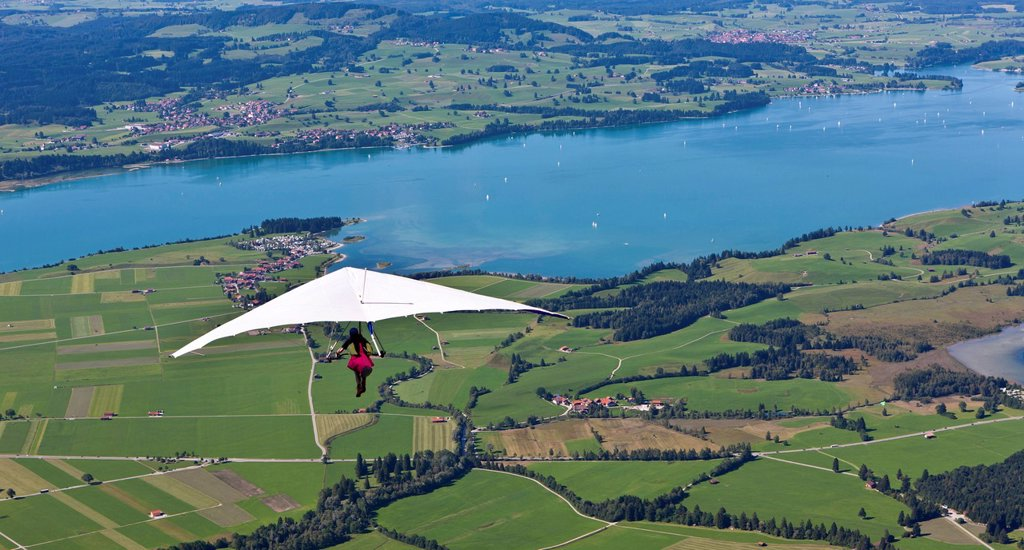 Hang gliding from Tegelberg Mountain, overlooking Froggensee lake, Upper Bavaria, Bavaria, Germany, Europe, PublicGround : Stock Photo