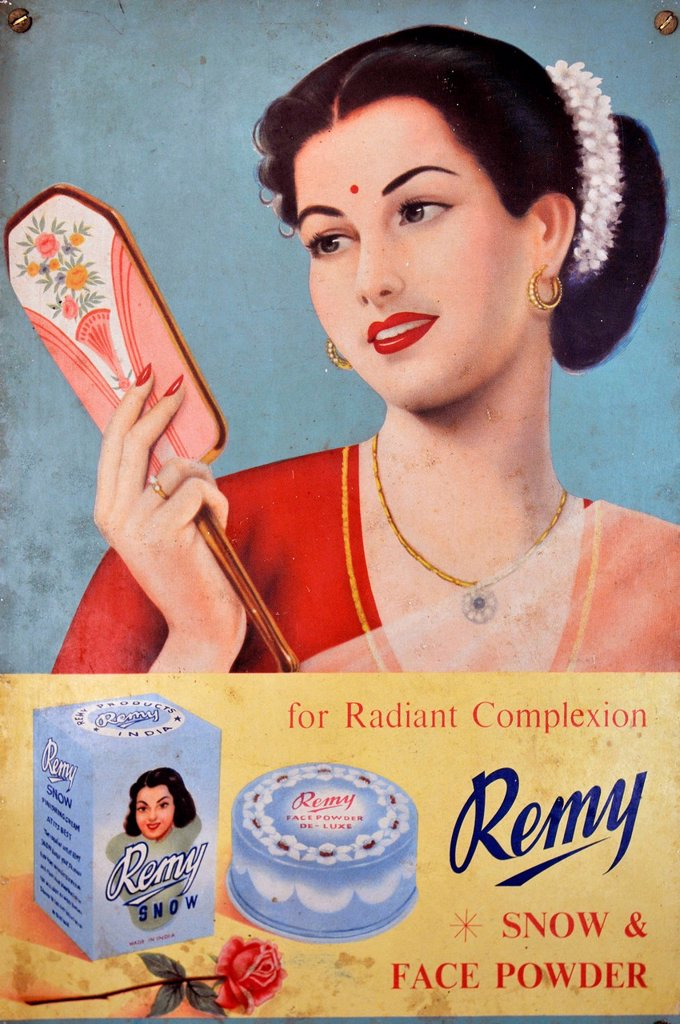Stock Photo: 1848-571050 Young Indian woman on a billboard for Remy, Swamimalai, Tamil Nadu, South India, India, Asia