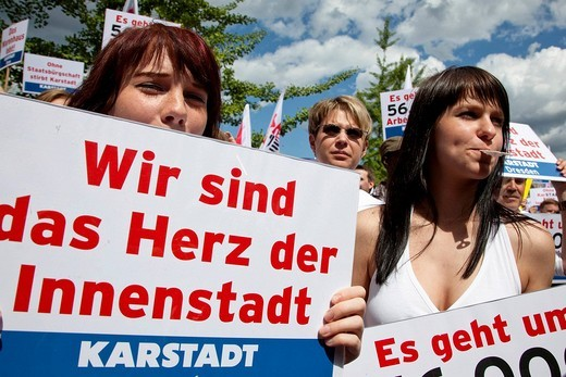 Employees of the marketing_ and tourism group Arcandor, formerly KarstadtQuelle, protesting in front of the Federal Ministry of Economy and Technology for the company´s rescue via government aid, Berlin, Germany, Europe : Stock Photo