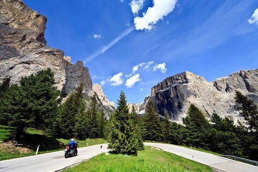 Motorcyclist in front of the the Sella massif in the Dolomites, Italy, Europe : Stock Photo