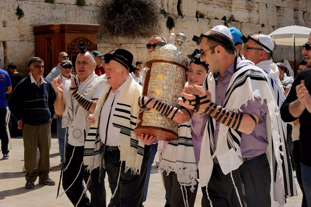 Bar Mitzvah celebration at the Western or Wailing Wall in the direction of the Jewish Quarter, boy is carrying the Torah scroll with the help of his father, Muslim Quarter, Old City, Jerusalem, Israel, Middle East : Stock Photo