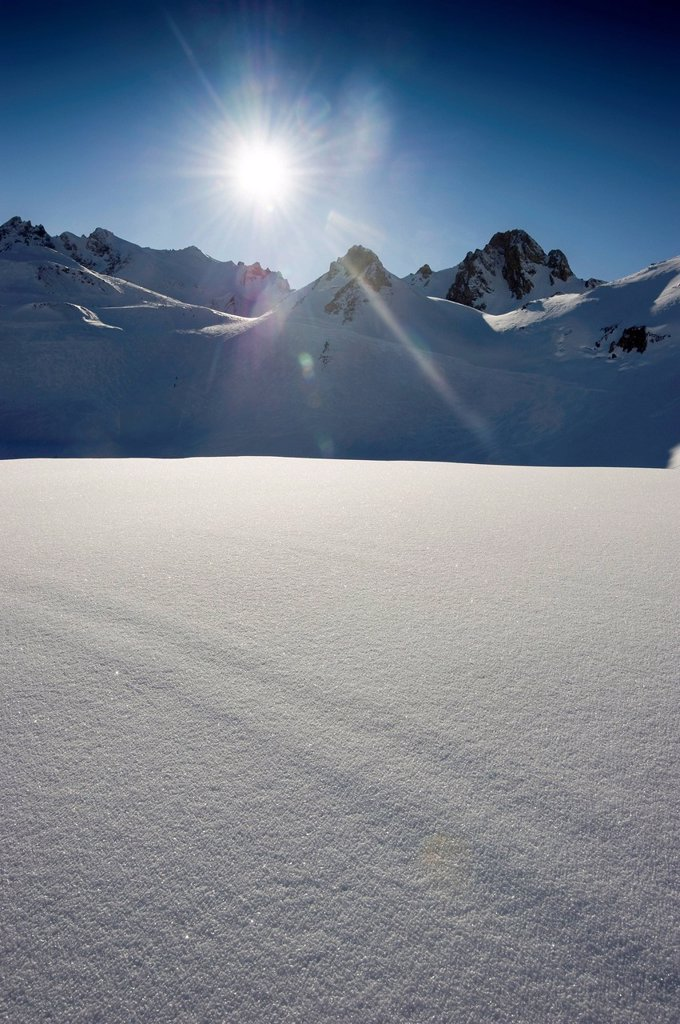 Stock Photo: 1848-571882 Deep snow with mountain peaks and the sun, Tignes, Val d´Isere, Savoie, Alps, France, Europe