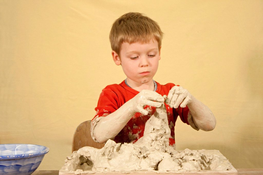 Stock Photo: 1848-571905 Boy doing art therapy with clay