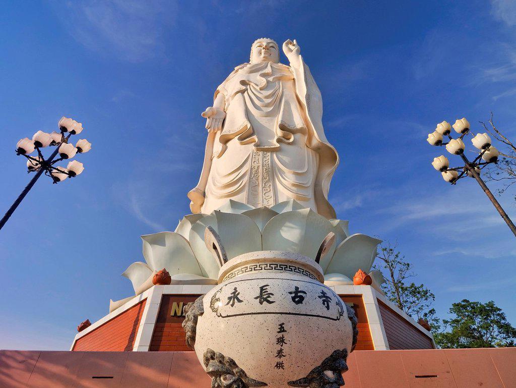 Buddha statue at Vinh Trang Pagoda, My Tho, Mekong Delta, Vietnam, Southeast Asia, Asia : Stock Photo