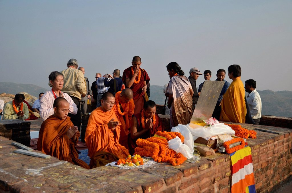 Stock Photo: 1848-572291 Monks and Buddhist dignitaries from Laos, Burma, Cambodia, Korea, Tibet, from all Buddhist traditions and schools gather for a communal prayer at Buddha´s first place of activity and meditation sites, Vulture Peak, important Buddhist pilgrimage destinatio. Monks and Buddhist dignitaries from Laos, Burma, Cambodia, Korea, Tibet, from all Buddhist traditions and schools gather for a communal prayer at Buddha´s first place of activity and meditation sites, Vulture Peak, important Buddhist pilgrimag