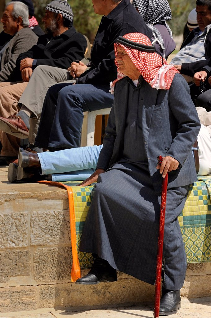 Palestinian man wearing a keffiyeh, kufiya, at a meeting listening, Temple Mount, Muslim Quarter, Old City, Jerusalem, Israel, Middle East : Stock Photo