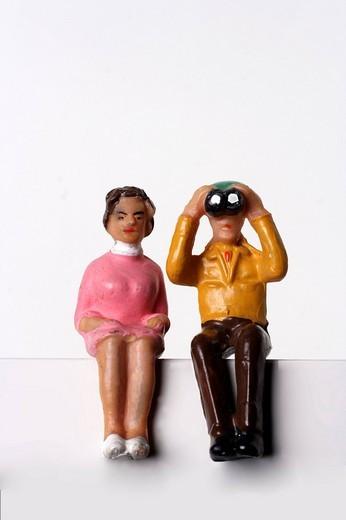 Stock Photo: 1848-57371 Pensioner looking through Binoculars