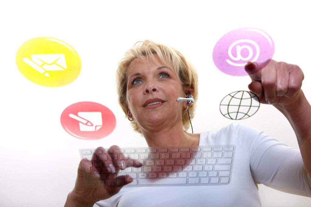 Woman at the workplace, symbolic image for the virtual office : Stock Photo