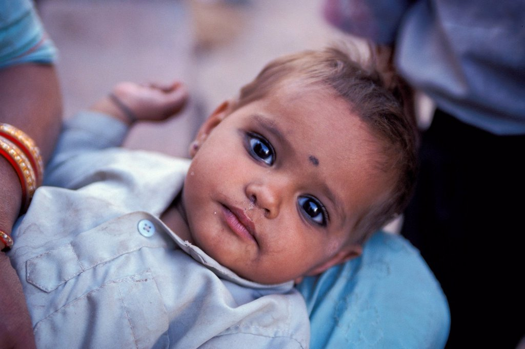 Stock Photo: 1848-574223 Infant with kohl rimmed eyes and a Bindi on its forehead, camel and cattle market of Nagaur, Rajasthan, India, Asia