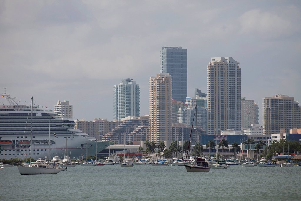 Stock Photo: 1848-574382 Cruise ship Carnival Valor in the harbour and the skyline of downtown Miami, Florida, USA