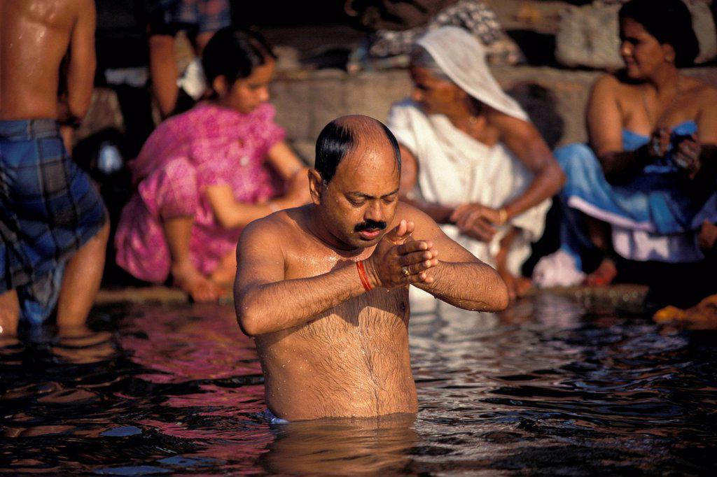 Stock Photo: 1848-574698 Hindu during his Puja morning prayer, Ganges River, Varanasi also known as Benaras, Uttar Pradesh, India, Asia