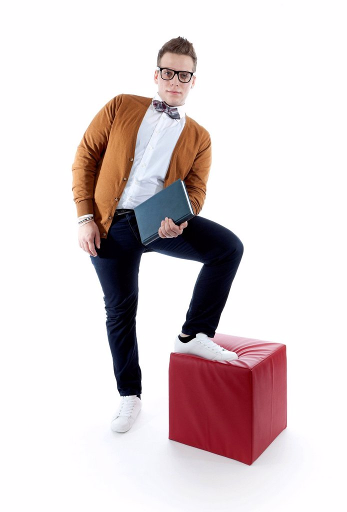Stock Photo: 1848-575169 Young man wearing glasses and a bow tie holding a book, agenda