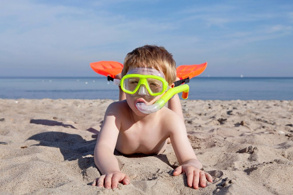 Young boy with diving goggles, snorkel and flippers, beach of Kuehlungsborn, Mecklenburg_Western Pomerania, Germany : Stock Photo