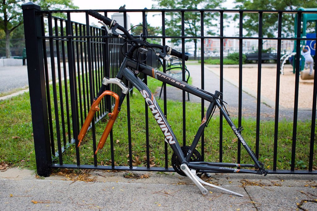 Stock Photo: 1848-577452 Remains of a bicycle, chained to a fence, Boston, Massachusetts, New England, USA