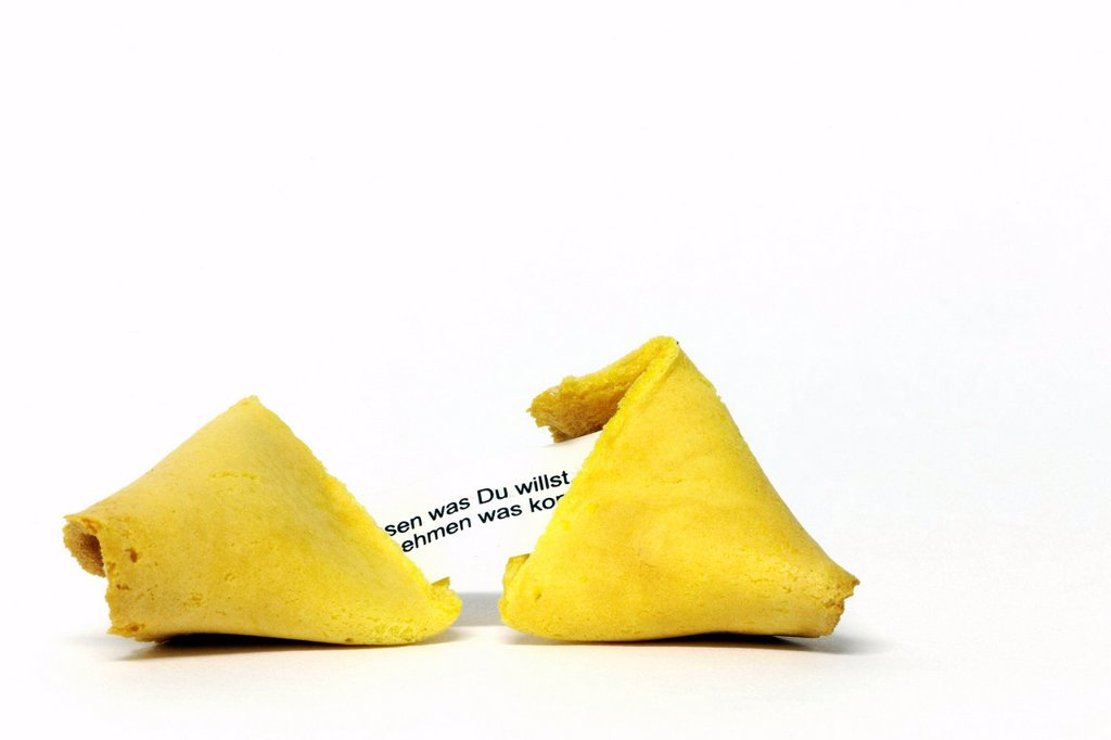 Stock Photo: 1848-577943 Opened Chinese fortune cookie with a wise message