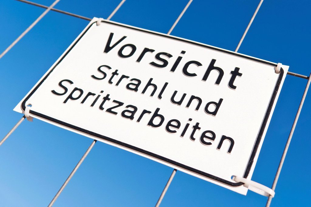 Sign ´´Vorsicht Strahl_ und Spritzarbeiten´´, German for ´´blasting and spraying works´´ : Stock Photo