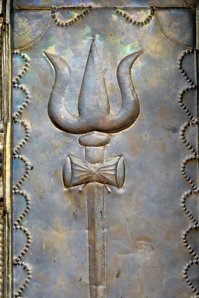 Relief representation of Shiva´s trident, Temple of Ettumanur, Kerala, South India, India, Asia : Stock Photo