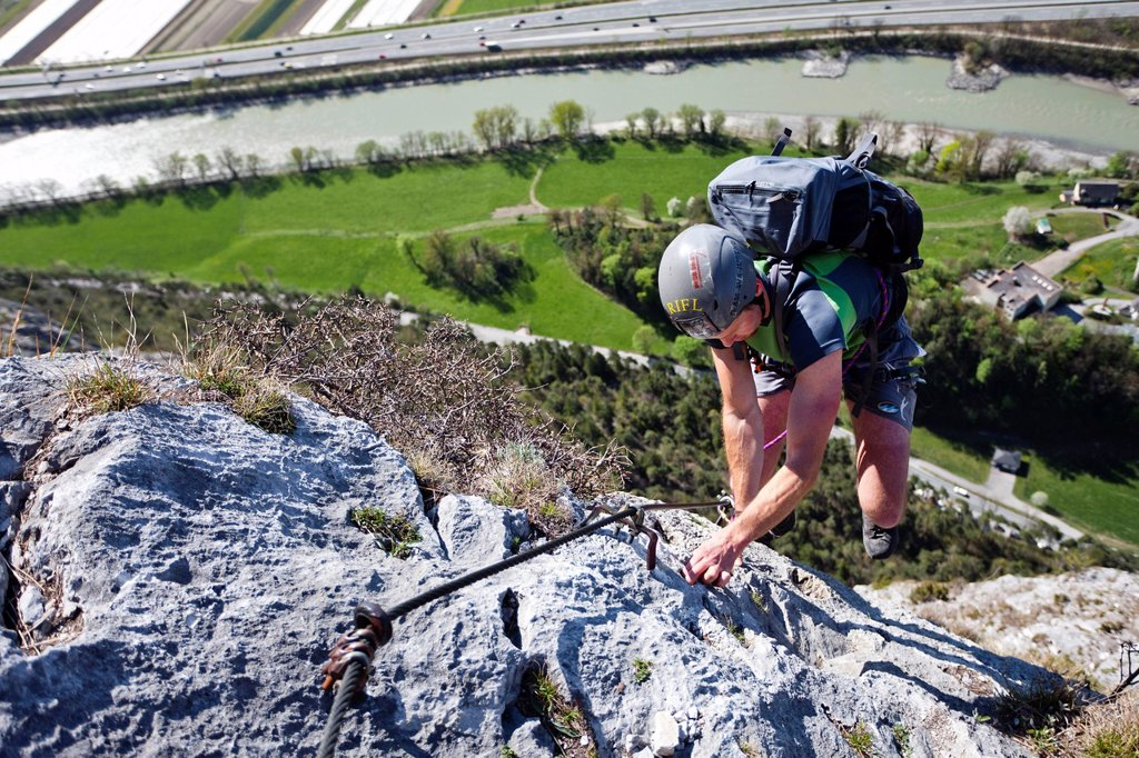 Stock Photo: 1848-579878 Climber at the Kaiser_Max via ferrata, at the Martinswand mountain face near Innsbruck, North Tyrol, Austria, Europe