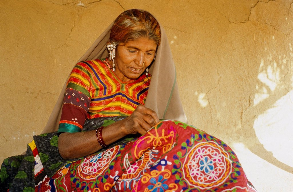 Stock Photo: 1848-579992 Woman making embroidery, villages in central Gujarat are famous for the different styles of embroidery, Bhirendiara, Gujarat, India, Asia