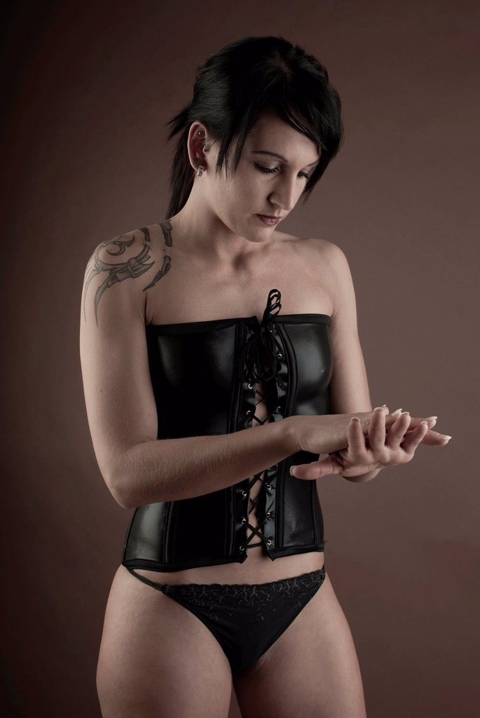 Woman, Gothic, tattoo, latex underwear, standing : Stock Photo