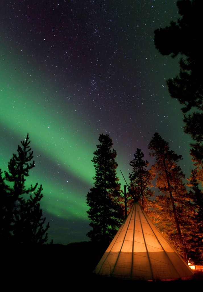 Illuminated teepee, tipi, tepee, Northern lights, Polar Aurorae, Aurora Borealis, green, near Whitehorse, Yukon Territory, Canada : Stock Photo