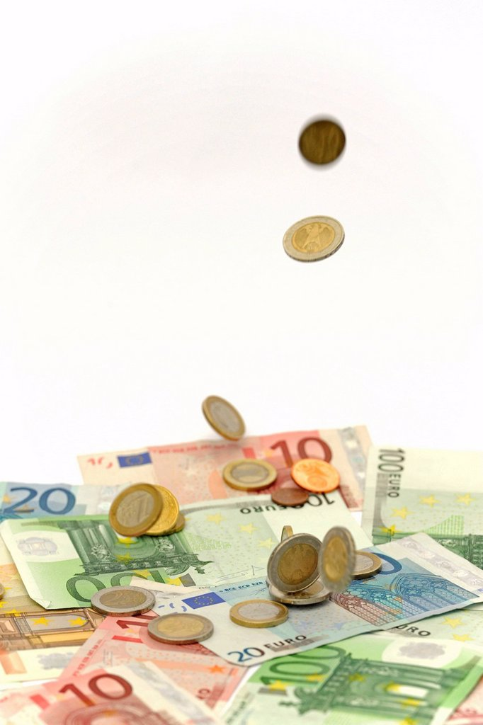 Stock Photo: 1848-581778 Euro coins falling onto Euro banknotes, symbolic image for windfall