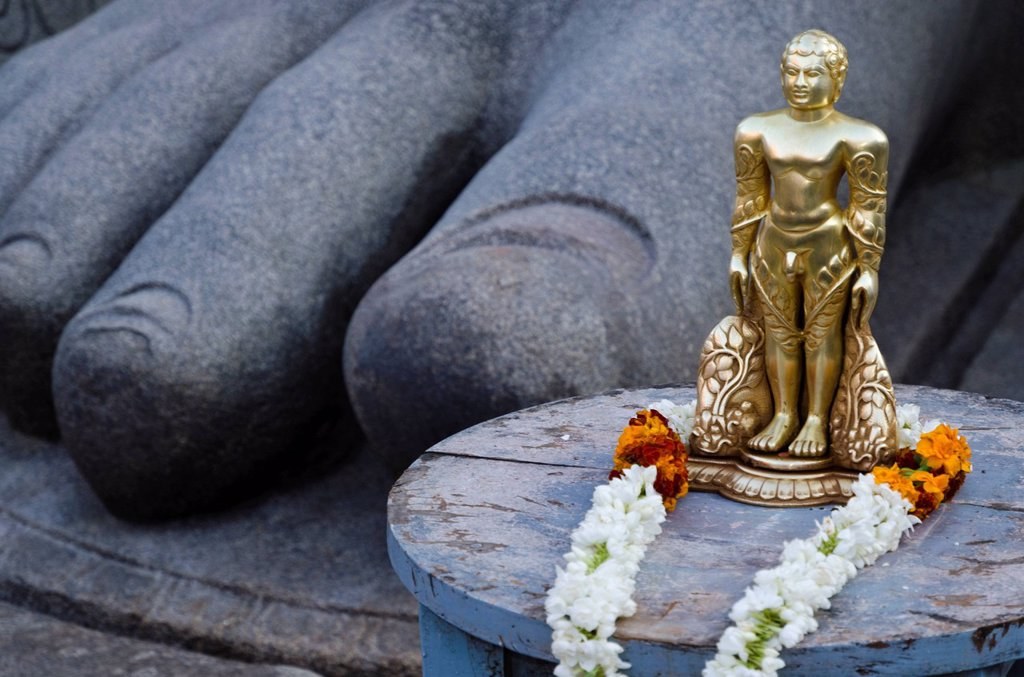 Stock Photo: 1848-583067 The small statue of Bahubali at the feet of the gigantic staue of Gomateshwara in Sravanabelagola, used for special rituals, Karnataka, India, Asia