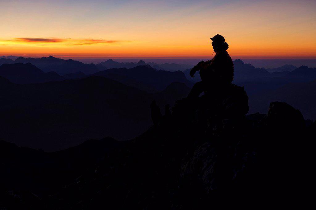 Mountain panorama with climber at sunset, Mt. Feuerspitze, Steeg, Lech, Ausserfern, Tyrol, Austria, Europe : Stock Photo