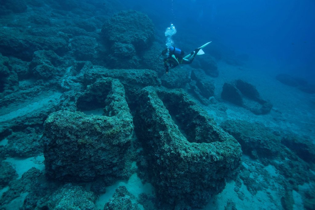A diver and ancient stone coffins, sarcophagi, near the Five Islands, off the Cape Gelydonia, Adrasan, Lycia, Turkey, Mediterranean Sea : Stock Photo